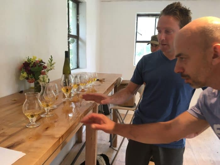 Discussing how the shape of the glass changes the cider with Corning glass artists